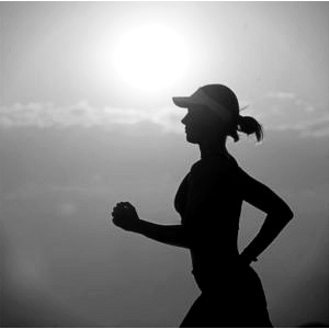 a woman's silhouette while jogger